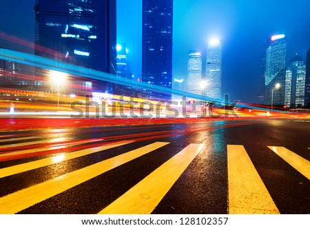 the light trails on the modern building background in shanghai china - stock photo