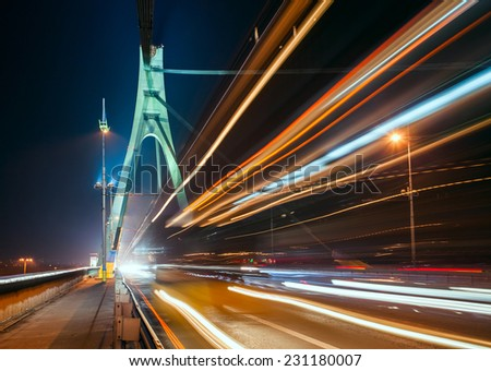The light trails on the Moscow bridge in Kiev at night - stock photo