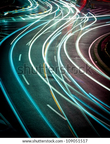 the light trails on the street in shanghai china. - stock photo