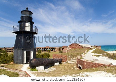 The lighthouse and cannon atop Fort Jefferson in the Dry Tortugas National Park - stock photo