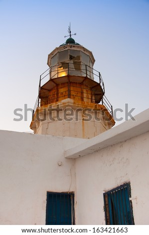 the lighthouse on the island of Mykonos. Greece. - stock photo