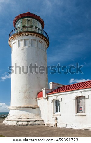 The lighthouse sitting atop the outermost point of Cape Disappointment, Washington. - stock photo