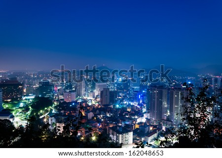 The lights of Seoul glimmer as dawn approaches. - stock photo