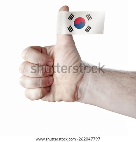 "The ""like"" - the thumb and the flag of South Korea - stock photo"