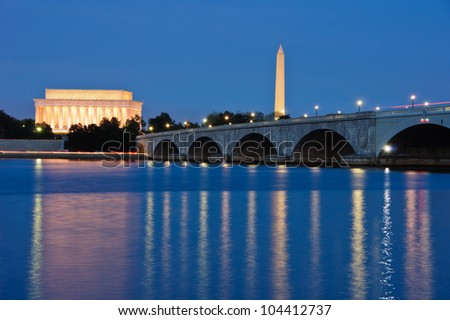 The Lincoln Memorial, Arlington Memorial Bridge and Washington Monument reflected in the Potomac River at dusk. Washington, DC - stock photo