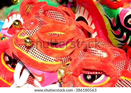 The Lion Head mask for Lion Dance. The lion dance is performed during Lunar New Year and other traditional, cultural festivals. It is also performed at business opening events or wedding ceremonies. - stock photo