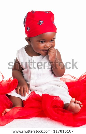 The little baby girl is dressed like a miniature biker child. - stock photo