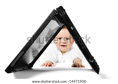 The little baby with a opened laptop. - stock photo