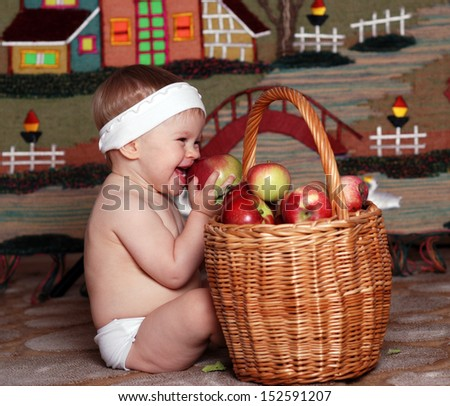 The little baby with red apples  - stock photo