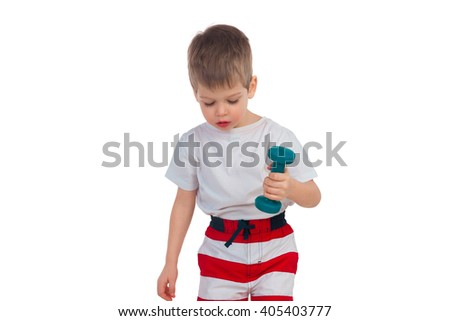 The little boy does exercises with dumbbells - stock photo