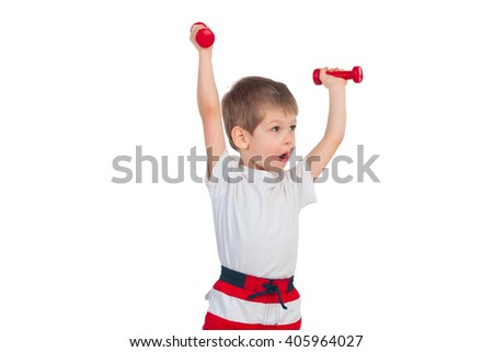 The little boy does exercises with two dumbbells isolated on white background - stock photo