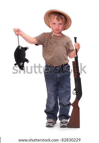 The little boy dressed on a safari suit with rifle holding big rat. - stock photo