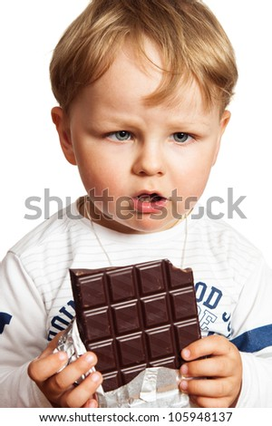 The little boy eats chocolate - stock photo