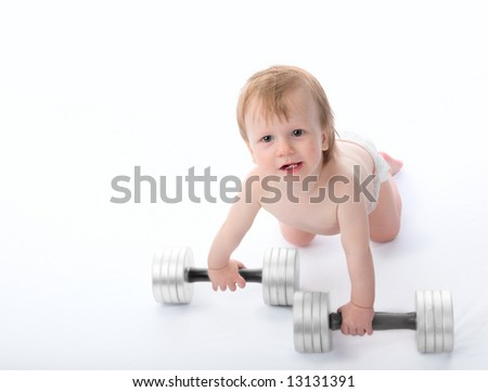 The little boy lifts dumbbells. On a white background. - stock photo