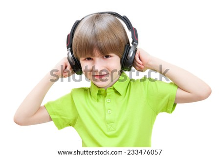 The little boy listens stereo music, isolated on white background. - stock photo