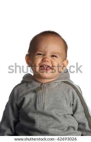 The little boy poses an attractive face - stock photo