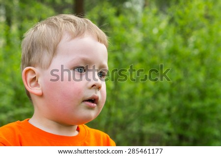 the little boy thoughtfully looks ahead - stock photo