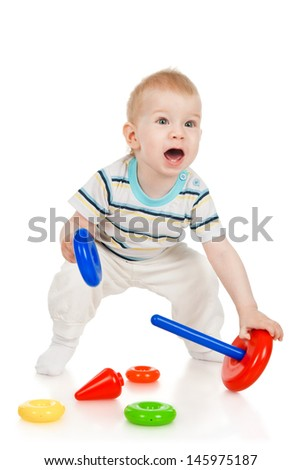 The little boy with a toy pyramid - stock photo