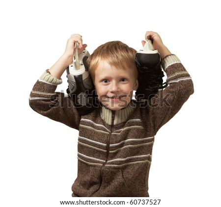 The little boy with the skates in a knitted sweater smiles in camera. Widely open eyes. The skates on shoulders. Isolated on white background. - stock photo