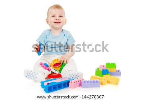 The little boy with toys - stock photo