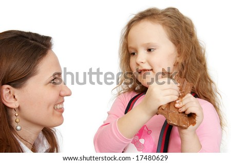 The little girl does not wish to share chocolate - stock photo