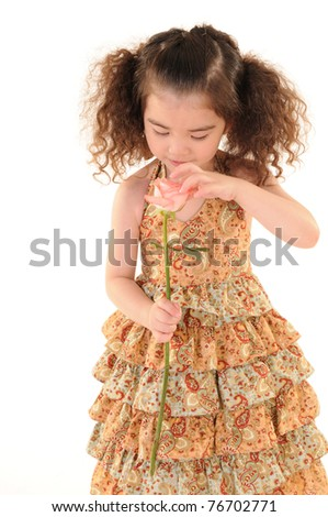 The little girl holding a flower. Isolated on white background - stock photo