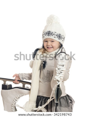 The little girl holds skates and rejoices - stock photo