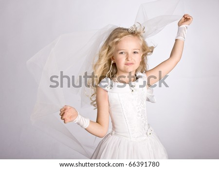 The little girl in a dress of the bride, studio shot - stock photo