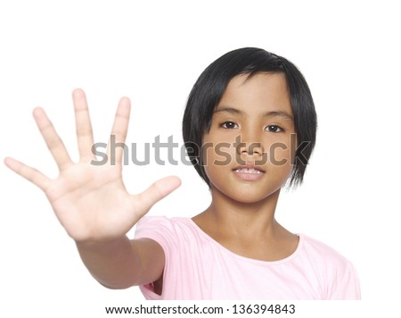 The little girl making Stop sign with his hand - stock photo