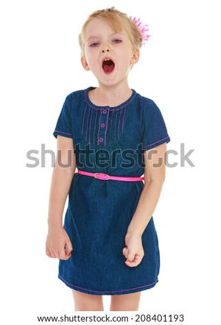 The little girl opened her mouth.kindergarten, the concept of childhood and joy, teens - stock photo