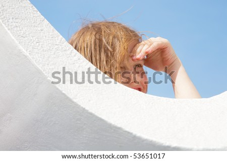 The little girl poses on architecture bends - stock photo