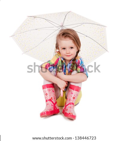 The little girl with an umbrella and in rubber boots. Isolated on a white background - stock photo