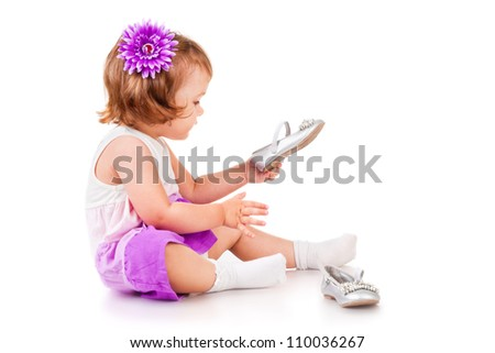 The little girl with shoes, isolated on white - stock photo