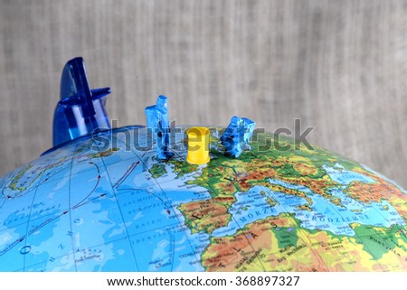 The little mans explores the environment globe. The concept of environmental protection. - stock photo