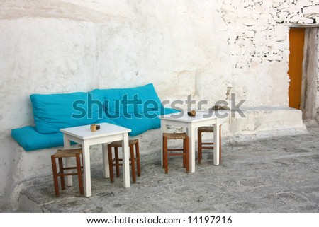 The little patio of a Greek island (Mykonos) coffee shop / bar - stock photo