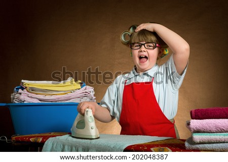 the little wife diligently irons, you are very tired. vintage-looking - stock photo