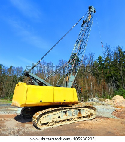 The loader excavator in a damaged landscape - road construction. - stock photo