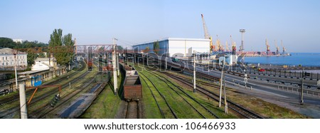 The logistics center. The transportation hub. A Railroad, a highway and a seaport. Panoramic image from several pictures. The file has native resolution - stock photo