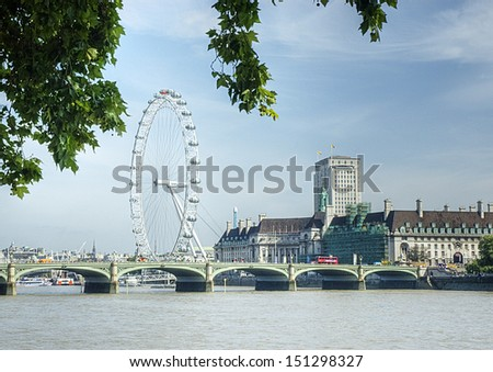 The London Eye Ferris wheel on the banks of the river Thames, - stock photo