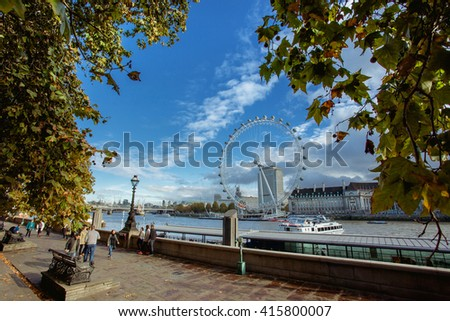 The London Eye on River   - stock photo