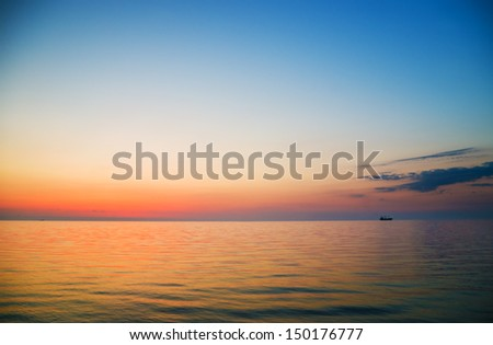 The lonely ship in the sea on a decline - stock photo