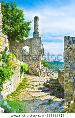 The long pipe of the chimney is the last preserved part of the house, Stari Bar, Montenegro. - stock photo