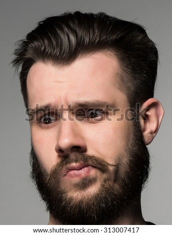 The looking down, thinking and puzzled man - stock photo