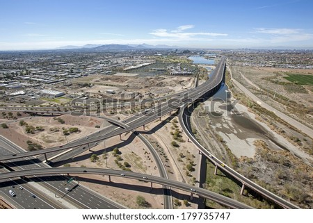 The Loop 101 and Loop 202 interchange looking west towards the Tempe Town Lake - stock photo