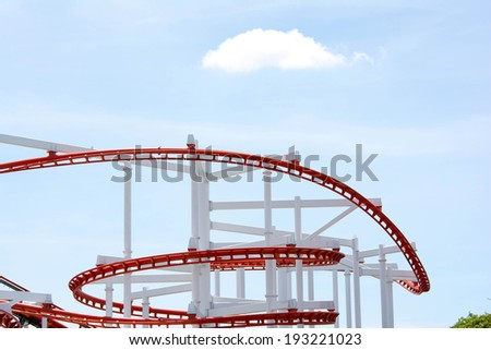 The loops of a scaring roller coaster.  - stock photo