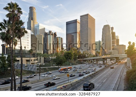 The Los Angeles skyline at sunset - stock photo