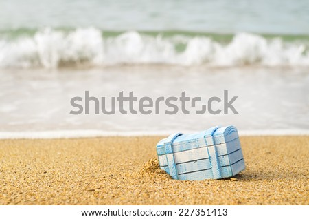 The lost chest with treasures on seacoast - stock photo