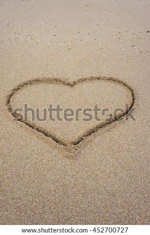 The love heart on the beach - stock photo