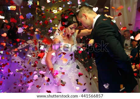 The lovely couple in love dancing on the dancefloor - stock photo