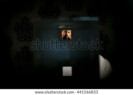 The lovely couple in love embracing in widow - stock photo